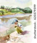 Boy Catching Fish In Stream....