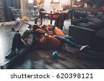 tired man and woman resting on... | Shutterstock . vector #620398121