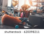 tired woman resting on beanbag... | Shutterstock . vector #620398211