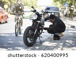 a motorist having problems with ... | Shutterstock . vector #620400995