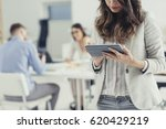 businesswoman using tablet in...   Shutterstock . vector #620429219