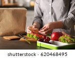 mother preparing sandwich for... | Shutterstock . vector #620468495