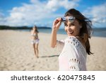 happy beautiful woman standing... | Shutterstock . vector #620475845