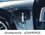 electric car charging on... | Shutterstock . vector #620490935