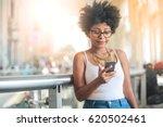 nice girl using her smart phone.... | Shutterstock . vector #620502461