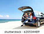 summer trip on beach by car and ... | Shutterstock . vector #620534489