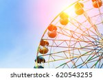 a colorful ferris wheel.... | Shutterstock . vector #620543255