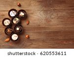 delicious chocolate candies on... | Shutterstock . vector #620553611