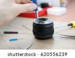 repair broken dslr camera lens... | Shutterstock . vector #620556239