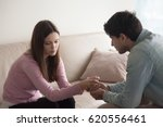 sad couple sitting opposite one ... | Shutterstock . vector #620556461