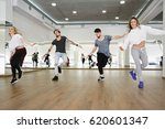 group of young modern dancers... | Shutterstock . vector #620601347