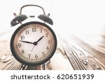Time Concept With Alarm Clock On Desk - stock photo