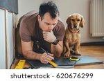 man doing renovation work at... | Shutterstock . vector #620676299