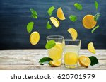 lemonade with flying lemon ... | Shutterstock . vector #620701979