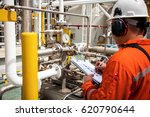technician technician in oil... | Shutterstock . vector #620790644