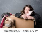 unhappy girl in old clothes... | Shutterstock . vector #620817749