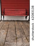 A Bench Of Red Painted Wood An...