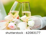 two champagne in hands of  new... | Shutterstock . vector #62083177
