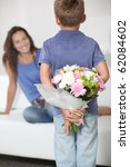 Little Boy Giving Flowers To...