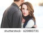 beautiful woman hugging a man | Shutterstock . vector #620883731