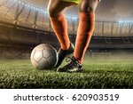 soccer player hits a ball | Shutterstock . vector #620903519