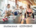 two sporty women doing... | Shutterstock . vector #620943845