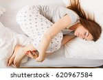 Small photo of Exhaustion relax dreaming sleep concept. Tired girl sleeping. Young lady resting in fetal position recovering in bed.