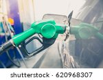 refilling the car with fuel on... | Shutterstock . vector #620968307