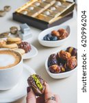 arabian sweets on a white table.... | Shutterstock . vector #620996204