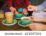 a table in a cafe with cups of... | Shutterstock . vector #621037241