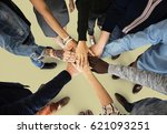 group of people holding hand... | Shutterstock . vector #621093251