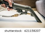 cleaning couch with steam... | Shutterstock . vector #621158207