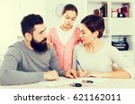young parents signing papers... | Shutterstock . vector #621162011