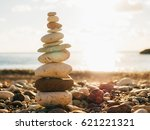 balance stones on the beach.... | Shutterstock . vector #621221321