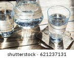 glass of water on a wooden... | Shutterstock . vector #621237131