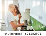 happy young couple preparing on ... | Shutterstock . vector #621252971