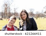 happy young mother and her nine ... | Shutterstock . vector #621266411