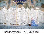 woman praying in the mosque and ... | Shutterstock . vector #621325451