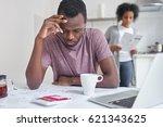 depressed bankrupt young... | Shutterstock . vector #621343625