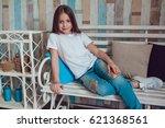 beautiful little girl in blank... | Shutterstock . vector #621368561
