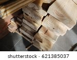 Stack of wood construction materials for building industry. - stock photo