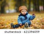 cute little boy in autumn park | Shutterstock . vector #621396059