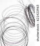 thin wire  in a muddle  tangled.... | Shutterstock . vector #621423965