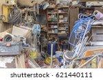a messy garage detail filled... | Shutterstock . vector #621440111