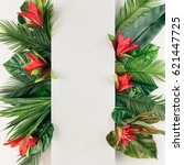 Small photo of Creative layout made of tropical palm leaves and colorful flowers. Summer concept. Flat lay.