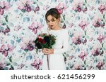 amazing bride with red bouquet... | Shutterstock . vector #621456299
