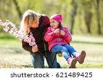 little girl giving present to... | Shutterstock . vector #621489425