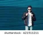 fashion male model posing in...