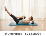 leg stretch exercise on yoga... | Shutterstock . vector #621518099