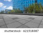 empty pavement and modern... | Shutterstock . vector #621518387